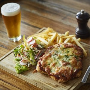 Baked meal with beer and fries
